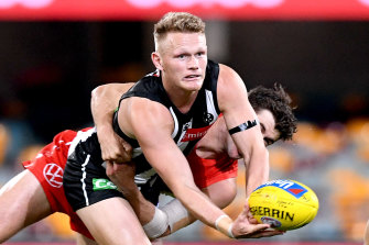 Adam Treloar's partner has signed with the Queensland Firebirds.