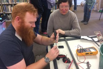 The Repair Cafe, where people help each other fix and re-use appliances.