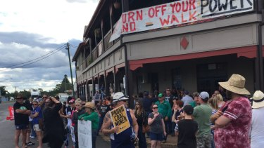 Protestors move to line the main streets of Clermont as the Stop Adani convoy arrives in early May.