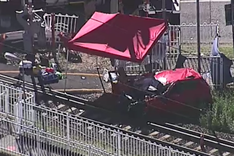 Woman dies after car and train crash at dangerous crossing