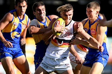 BRISBANE, AUSTRALIA - JULY 11: Ben Keays of the Crows is caught by the defence during the round 6 AFL match between the West Coast Eagles and the Adelaide Crows at The Gabba on July 11, 2020 in Brisbane, Australia. (Photo by Bradley Kanaris/Getty Images)