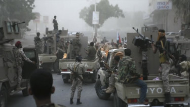 Southern Transitional Council separatist fighters line up to storm the presidential palace in the southern port city of Aden, Yemen, on Friday.