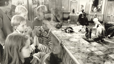 Children enthralled by the Myer Christmas windows on December 20, 1991
