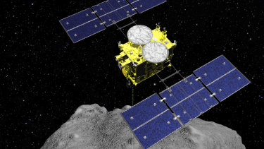 The Hayabusa2 spacecraft is seen above on the asteroid Ryugu In this computer graphics image released by the Japan Aerospace Exploration Agency (JAXA).