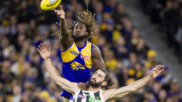 Eagle Nic Naitanui soars over Brodie Grundy at Optus Stadium – but Collingwood became the second team this year to knock off the Eagles at home.