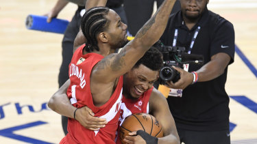 Triumph: Toronto Raptors forward Kawhi Leonard, left, and guard Kyle Lowry celebrate the team's win on Thursday.