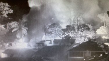 CCTV footage shows smoke from burning homes in Aurukun during unrest on New Year's Day.