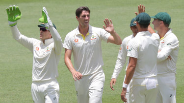 Fine margins: Pat Cummins (second left) is congratulated after dismissing Virat Kohli with controversial catch by Peter Handscomb.