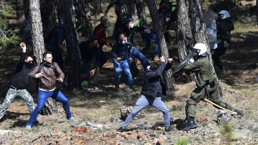 Protesters clash with riot police over plans to build an asylum seeker detention centre in Karava, Lesbos.