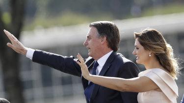 Brazil's new President Jair Bolsonaro, accompanied by his wife Michelle Bolsonaro, at the swearing in ceremony.