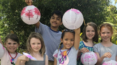 Children at the 'Paint a lantern' Lunar New Year event in the Royal Botanic Gardens.