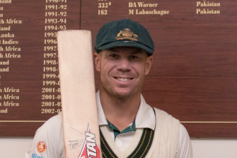 David Warner in front of the Adelaide Oval honour board.