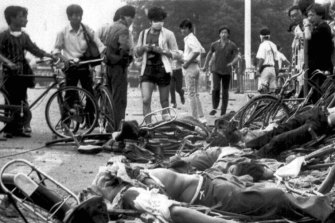 The bodies of dead civilians lie among mangled bicycles near Beijing's Tiananmen Square on June 4.