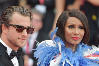 Francesco Carrozzini and Iman walk the red carpet before the opening ceremony of the 76th Venice Film Festival.