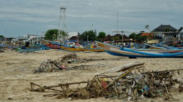 Plastic trash piled up among the fishing boats waiting for pick up at Kedonganan Beach in Bali.