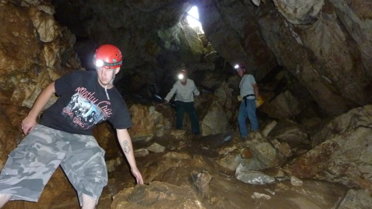 Exploring the Cotter Cave.