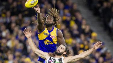 Eagle Nic Naitanui soars over Brodie Grundy at Optus Stadium but Collingwood became the second team this year to knock off the Eagles at home.