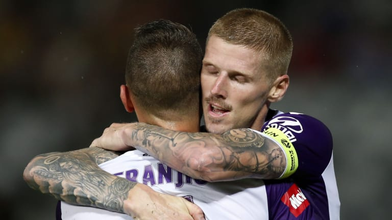 Icing on the cake: Andy Keogh celebrates his late goal with Ivan Franjic.