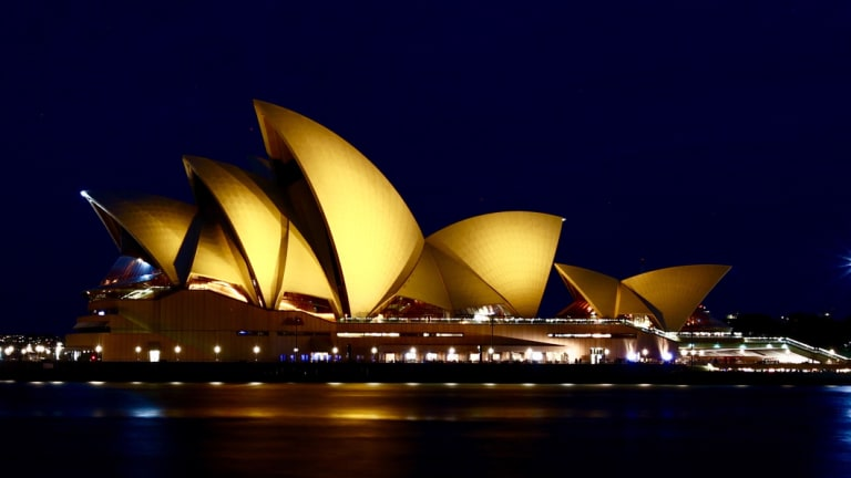 The Sydney Opera House , illuminated in gold for children's cancer research.