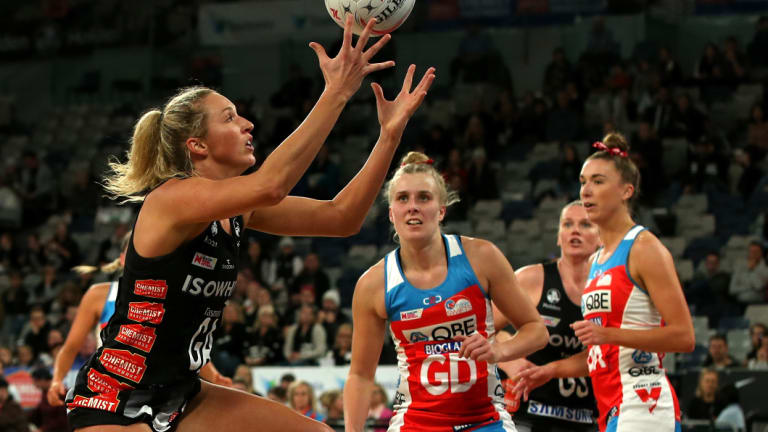 Crunch play: Erin Bell of the Magpies receives a pass against the Swifts. She tied the scores with just seconds left in the game.