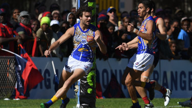 Jack flash: West Coast forward Jack Petruccelle (left) celebrates booting a goal for the Eagles against Melbourne at TIO Traeger Park in Alice Springs.