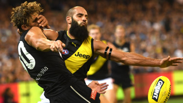 Tiger Bachar Houli takes on Carlton's Charlie Curnow  in round one of the 2019 AFL season.