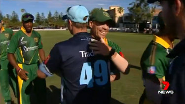 Smiling again: The former Test teammates acknowledge each other at the end of the match.