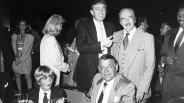 Donald Trump points to his father, Fred Trump at Trump Plaza Hotel, when Donald Trump jnr (front left) was still a child.
