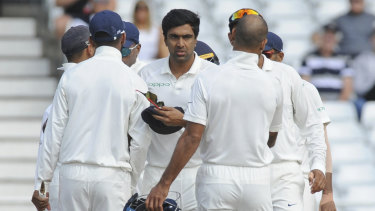 All out: India's Ravichandran Ashwin, center, is congratulated by teammates after the dismissal of James Anderson, England's last wicket, during the fifth day in Nottingham.