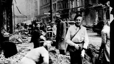 Germans civilians clean up widespread damage to Berlin in 1945.
