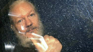 Julian Assange is driven from the Ecuadorian embassy in London after his arrest in April.