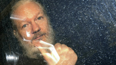 Julian Assange is driven from the Ecuadorian embassy in London after his arrest in April 2019.