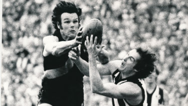 Tigers defender Francis Bourke attempts to spoil a mark by Magpie Ricky Barham in the 1980 VFL grand final.
