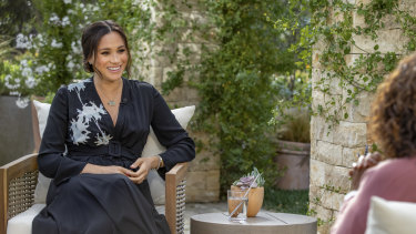 Meghan, Duchess of Sussex, left, speaking with Oprah Winfrey during the interview.