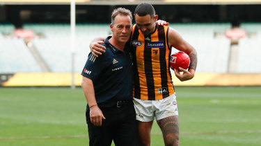 Alastair Clarkson and Shaun Burgoyne leave the MCG for the final time in Hawks colours.
