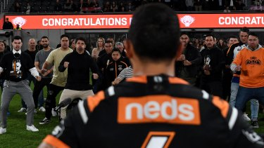 Another milestone: Benji Marshall watches friends and family perform a haka after his 300th NRL match in July.