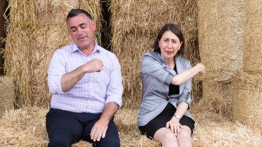NSW Premier Gladys Berejiklian, and Deputy Premier, John Barilaro, on Boyd Baling farm in Lismore, in March.
