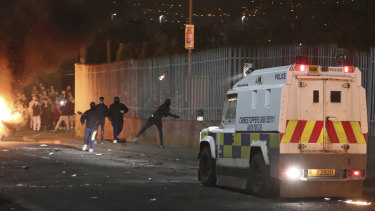Petrol bombs are thrown at police in Creggan, Londonderry, in Northern Ireland.