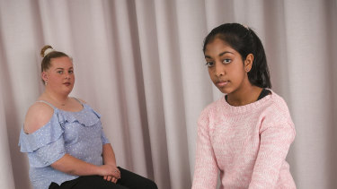Year 10 student Natasha McIntyre and year 7 student student Binusha Pathirana say it's unfair to be punished when their peers misbehave.