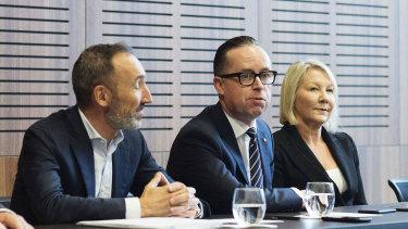 Alan Joyce (centre), with Jetstar boss Gareth Evans and Qantas International CEO Alison Webster on Monday.