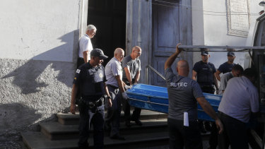 Police remove the body of a shooting victim from the Metropolitan Cathedral in Campinas.