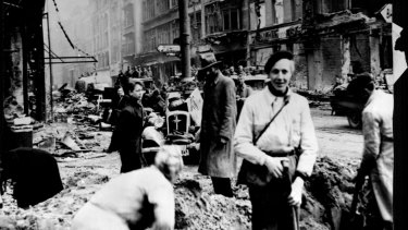 Germans civilians clean up widespread damage to Berlin in 1945.
