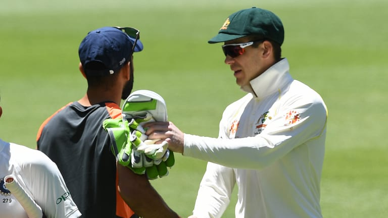 Polite: After their earlier clashes, Tim Paine and Virat Kohli shake hands.