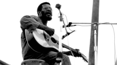 Richie Havens on stage at Woodstock.