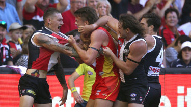 Saints and sinners: St Kilda's Matthew Parker (far left) tussles with Gold Coast's Charlie Ballard.