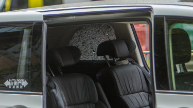 The windows of a passing SUV were shattered in the explosion, injuring one man inside.