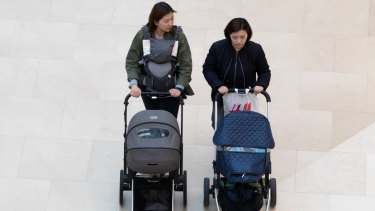 Two women push baby strollers in the Starfield Hanam shopping complex in Hanam, Gyeonggi, South Korea.