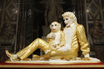 """U.S. artist Jeff Koons' sculpture """"Michael Jackson and Bubbles"""" at displayed at the Versailles in 2008."""