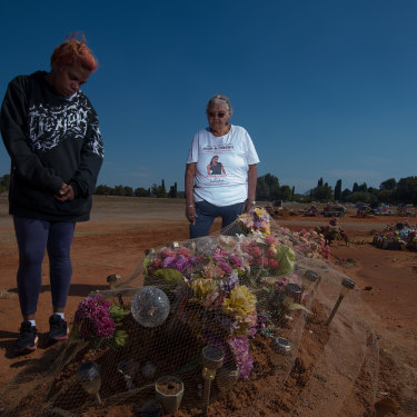 Sherona Roe and Carol Roe at the grave of  Ms Dhu in the Geraldton cemetery.