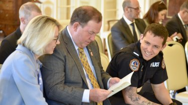 Constable Zach Rolfe at Government House with his parents Debbie and Richard.